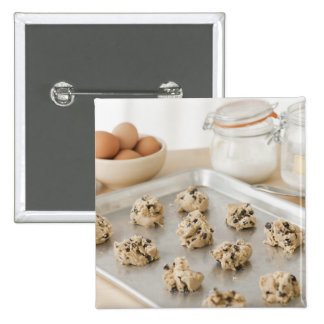 Raw cookies on baking tray 2 inch square button