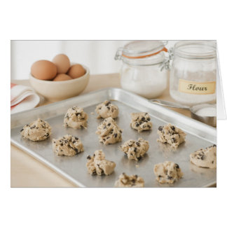 Raw cookies on baking tray card