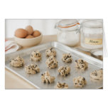 Raw cookies on baking tray greeting card