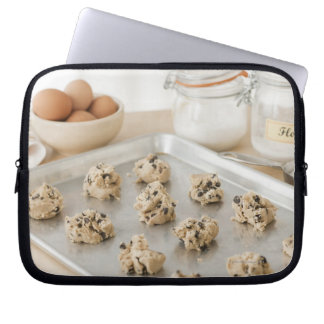 Raw cookies on baking tray laptop sleeve