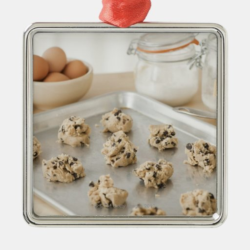 Raw cookies on baking tray metal ornament