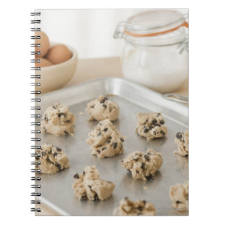 Raw cookies on baking tray note books