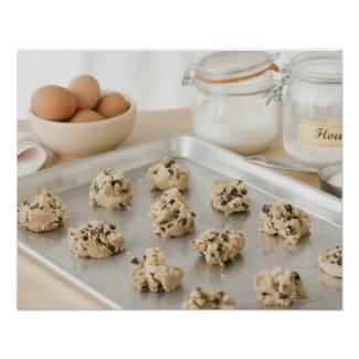 Raw cookies on baking tray posters