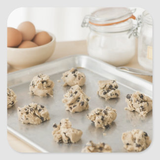 Raw cookies on baking tray square sticker