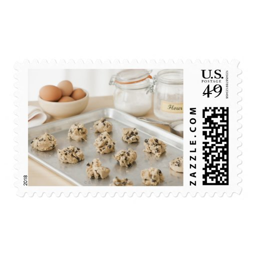 Raw cookies on baking tray stamp