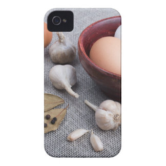 Raw eggs and garlic and spices on the kitchen iPhone 4 cover