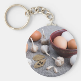 Raw eggs and garlic and spices on the kitchen keychain