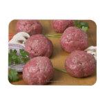 Raw meatballs on a cutting board flexible magnet
