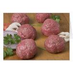 Raw meatballs on a cutting board greeting card