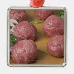 Raw meatballs on a cutting board ornament