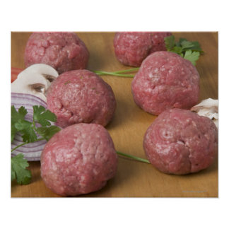 Raw meatballs on a cutting board poster