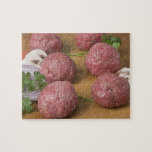 Raw meatballs on a cutting board puzzle