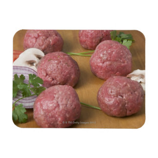 Raw meatballs on a cutting board rectangular photo magnet