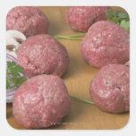 Raw meatballs on a cutting board sticker