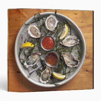 Raw oysters arranged 3 ring binder