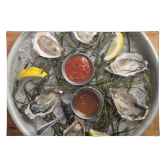 Raw oysters arranged cloth placemat