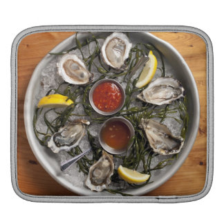 Raw oysters arranged sleeves for iPads