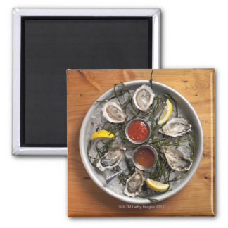 Raw oysters arranged magnet