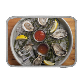Raw oysters arranged sleeves for MacBook air