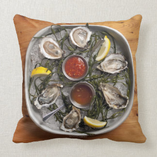 Raw oysters arranged throw pillow