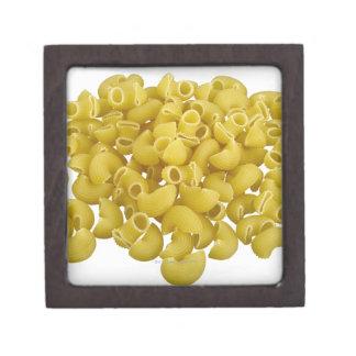 Raw pasta isolated on white background gift box