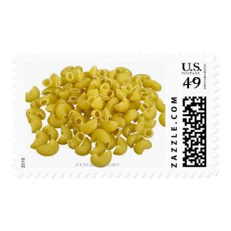 Raw pasta isolated on white background postage