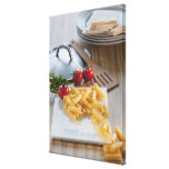 Raw pasta on weight scale canvas print