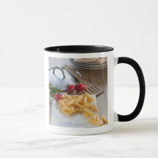 Raw pasta on weight scale mug