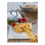 Raw pasta on weight scale postcard