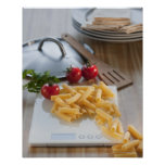 Raw pasta on weight scale poster