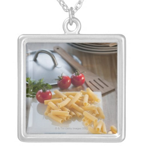 Raw pasta on weight scale square pendant necklace