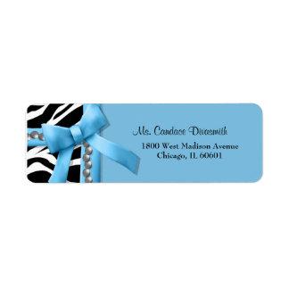 Raya azul clara y blanca de la cebra con las gemas etiqueta de remite