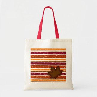 Raya roja y anaranjada de la bolsa de asas del oto