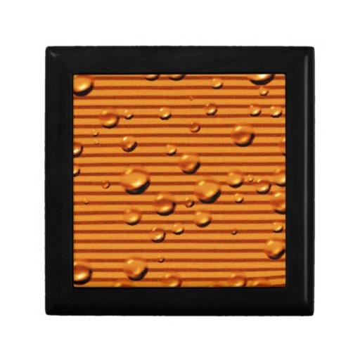 rayados anaranjados del oro mojaron cajas de joyas