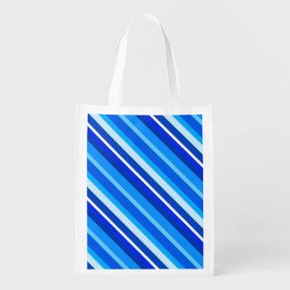 Rayas acodadas del caramelo - cobalto y azul claro bolsas de la compra
