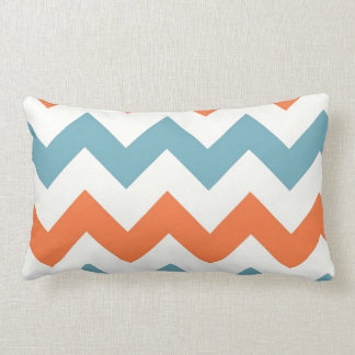 Rayas azules y anaranjadas en colores pastel de cojin