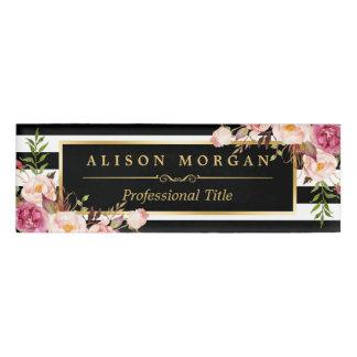 Rayas blancas negras de embalaje florales del oro etiqueta con nombre