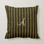 Rayas del brillo del oro del monograma almohada