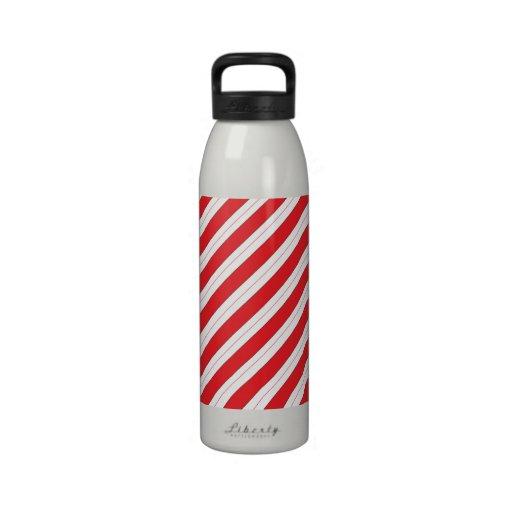 Rayas del rojo del bastón de caramelo botella de agua