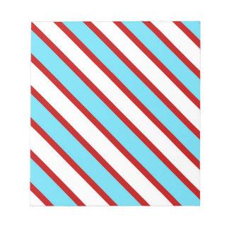 Rayas diagonales del rojo de azules turquesas de l bloc de papel
