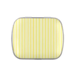 Rayas en amarillo, limón y la lata blanca del cara jarrones de caramelos