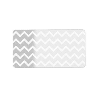 Rayas grises y blancas del zigzag etiqueta de dirección