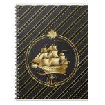 Rayas metálicas de oro del oro del velero y del an cuaderno