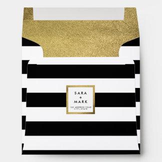 Rayas negras y blancas con la hoja de oro sobres