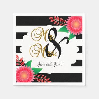 Rayas negras y blancas, flores rosadas del oro el servilleta desechable