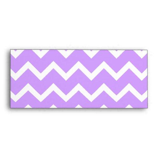 Rayas púrpuras y blancas del zigzag sobre