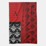Rayas rojas del damasco del nombre y del monograma toalla