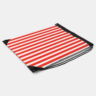 Rayas rojas y blancas del circo de la cabaña mochila