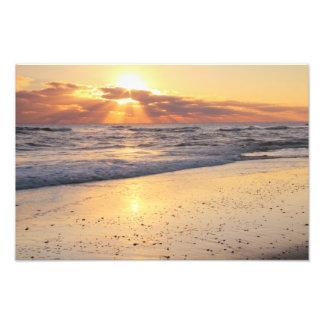 Rayos de sol en la playa fotografías