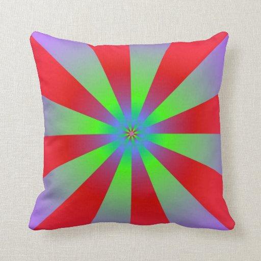 Rayos de sol en lila roja y almohadas verdes